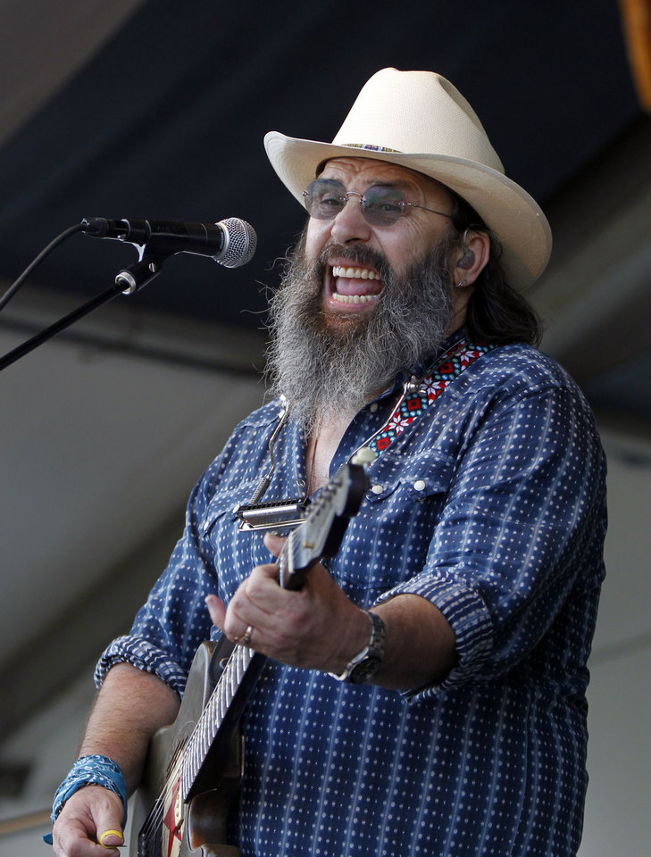 Steve Earle performs at the New Orleans Jazz and Heritage Festival in New Orleans, Saturday, May 5, 2012. (AP Photo/Gerald Herbert)