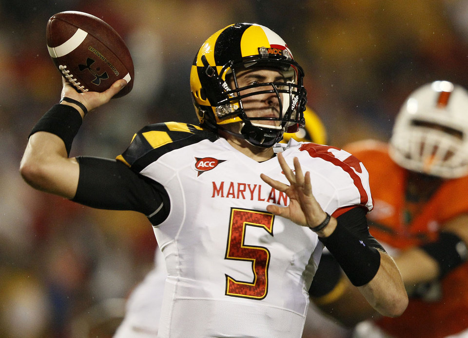 Maryland quarterback Danny O'Brien throws to a receiver in the first half of an NCAA football game against Miami in College Park, Md., Monday, Sept. 5, 2011. (AP Photo/Patrick Semansky) ORG XMIT: MDPS106