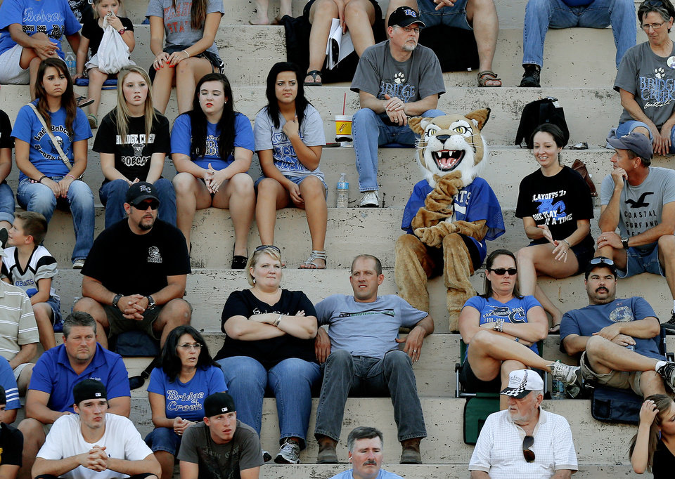 Photo - The Bridge Creek mascot sits in the stands during a high school football game between John Marshall and Bridge Creek at Taft Stadium in Oklahoma City, Thursday, September 6, 2012. Photo by Bryan Terry, The Oklahoman