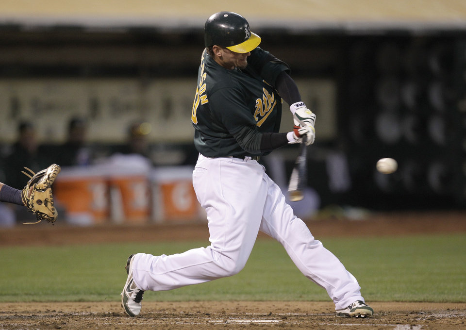 Photo -   Oakland Athletics' Josh Donaldson connects for a two-run home run off Boston Red Sox's Aaron Cook in the second inning of a baseball game Friday, Aug. 31, 2012, in Oakland, Calif. (AP Photo/Ben Margot)
