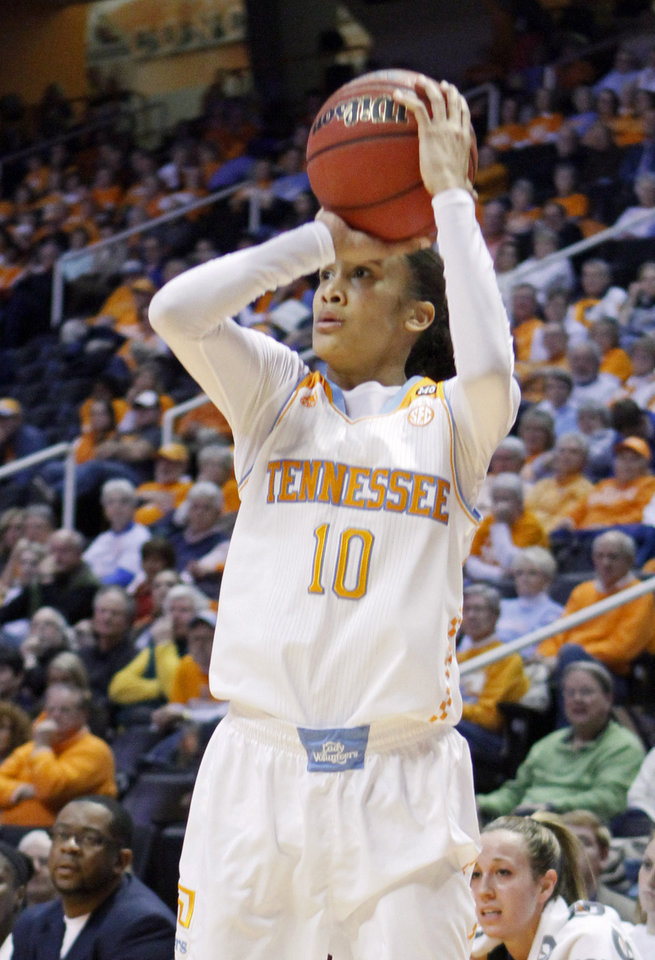 Photo - Tennessee guard Meighan Simmons (10) shoots in the first half of an NCAA college basketball game against Florida Thursday, Jan. 23, 2014, in Knoxville, Tenn. (AP Photo/Wade Payne)