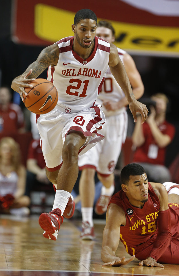 Photo - Oklahoma Sooner's Cameron Clark (21) gets the loose ball in front of Iowa State Cyclone's Naz Long (15) as the University of Oklahoma Sooners (OU) men play the Iowa State Cyclones (ISU) in NCAA, college basketball at The Lloyd Noble Center on Saturday, Jan. 11, 2014  in Norman, Okla. Photo by Steve Sisney, The Oklahoman