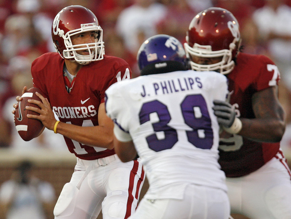 Photo - Oklahoma's Sam Bradford (14) stands in the pocket behind the protection of Phil Loadholt (79) who blocks TCU's Jason Phillips (39) during the first half of the college football game between the University of Oklahoma Sooners (OU) and Texas Christian University Horned Frogs (TCU) at the Gaylord Family -- Oklahoma Memorial Stadium on Saturday, Sept 27,  2008, in Norman, Okla.  by Chris Landsberger, The Oklahoman ORG XMIT: KOD