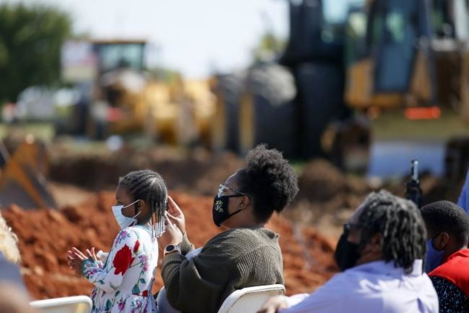 Photo -  A crowd watches during the groundbreaking for a new Homeland grocery store at the corner of NE 36 and Lincoln Boulevard in Oklahoma City Thursday.  [Bryan Terry/The Oklahoman]