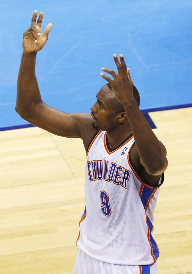 Photo - Serge Ibaka (9) reacts to a Thunder run during Game 2 of the Western Conference semifinals in the NBA playoffs between the Oklahoma City Thunder and the Los Angeles Clippers at Chesapeake Energy Arena in Oklahoma City, Wednesday, May 7, 2014. Photo by Sarah Phipps, The Oklahoman