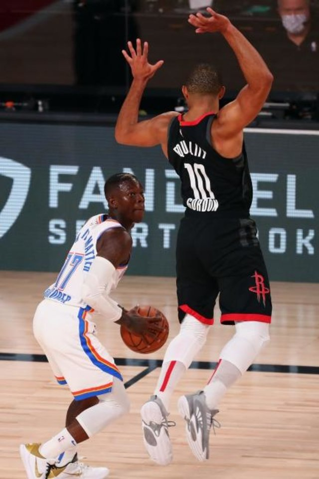 Photo -  Dennis Schröder (17) looks past a leaping Eric Gordon (10) during the second half in the Thunder's Game 4 win against the Rockets on Monday in Lake Buena Vista, Fla. [Kim Klement/USA TODAY Sports]
