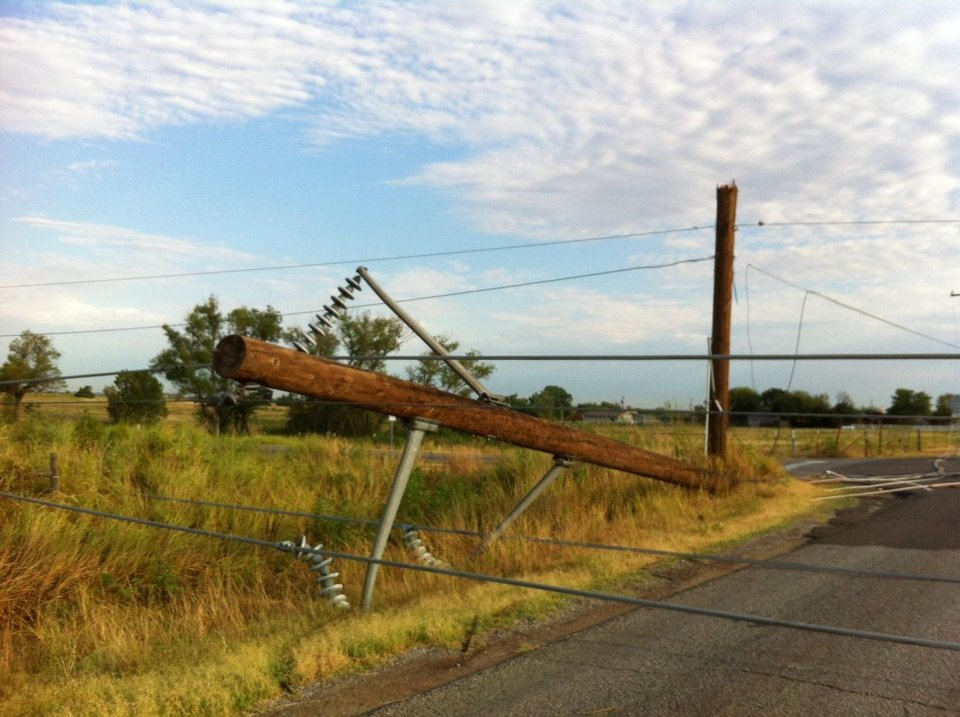 Photo - A power pole down at NW 164 and N MacArthur - Photo by Robert Medley