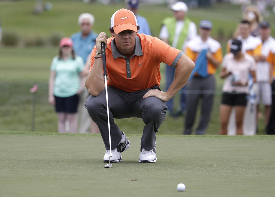 Photo - Rory McIlroy of Northern Ireland lines up a putt on the fourth hole during the first round of the Honda Classic golf tournament, Thursday, Feb. 27, 2014, in Palm Beach Gardens, Fla. (AP Photo/Lynne Sladky)