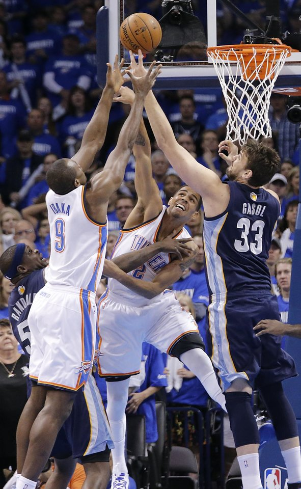 Oklahoma City\'s Thabo Sefolosha (2) and Serge Ibaka (9) battle for a rebound with Memphis\' Marc Gasol (33) and Zach Randolph (50) during the second round NBA playoff basketball game between the Oklahoma City Thunder and the Memphis Grizzlies at Chesapeake Energy Arena in Oklahoma City, Sunday, May 5, 2013. Photo by Chris Landsberger, The Oklahoman