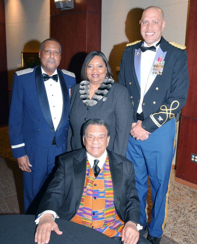 Photo - Andrew Young, seated; Gen. (Ret.) Tom L. Daniels,, Antoinette L. Roach;  Michael C. Thompson. PHOTO PROVIDED.