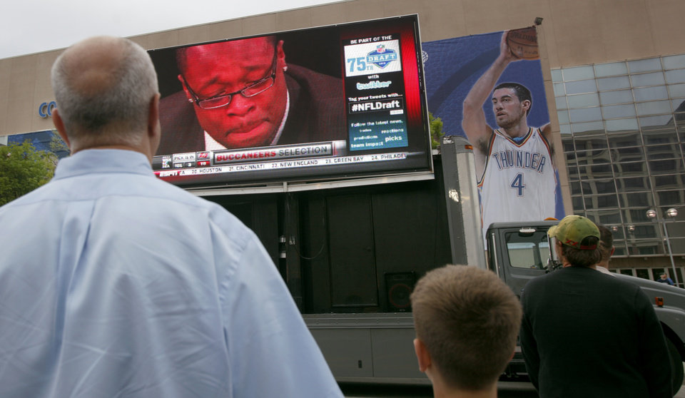 Photo - Fans watch former Oklahoma's Gerald McCoy being drafted before the basketball game between the Los Angeles Lakers and the Oklahoma City Thunder in the first round of the NBA playoffs at the Ford Center in Oklahoma City, Thursday, April 22, 2010. Photo by Sarah Phipps, The Oklahoman