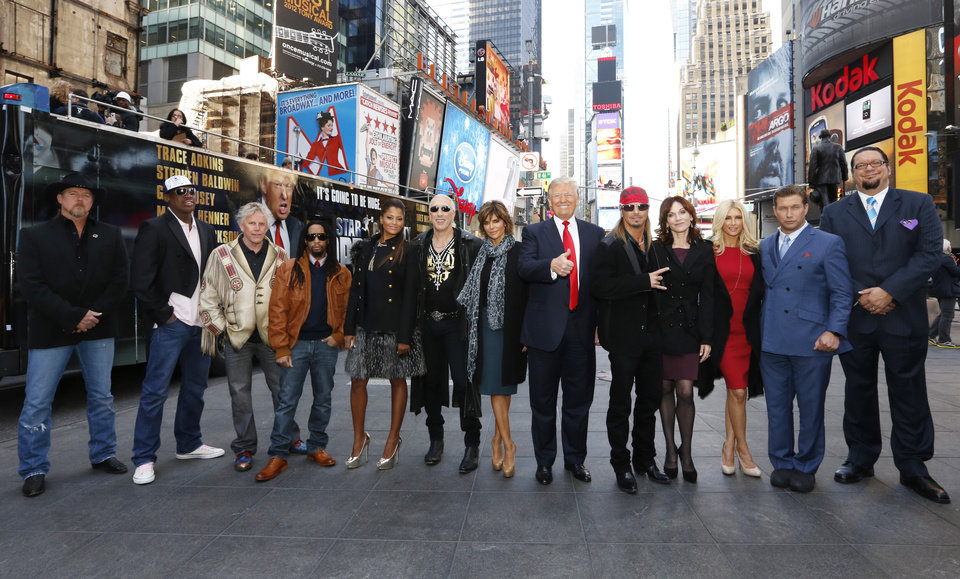 "This image released by NBC shows the new cast of ""All-Star Celebrity Apprentice,"" from left, Trace Adkins, Dennis Rodman, Gary Busey, Lil Jon, Claudia Jordan, Dee Snider, Lisa Rinna, show creator Donald Trump, Bret Michaels, Marilu Henner, Brande Roderick, Stephen Baldwin and Penn Jillette, posing in New York's Times Square, Friday, Oct. 12, 2012. The cast, all contestants on previous seasons of ""Celebrity Apprentice"", will begin taping on Monday, Oct. 15, for the new season airing in March. (AP Photo/NBC, Heidi Gutman)"