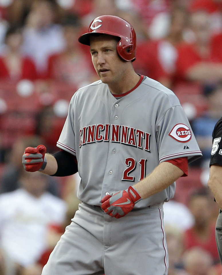 Photo - Cincinnati Reds' Todd Frazier stands on third after hitting a two-run triple during the second inning of a baseball game against the St. Louis Cardinals Monday, Aug. 26, 2013, in St. Louis. (AP Photo/Jeff Roberson)
