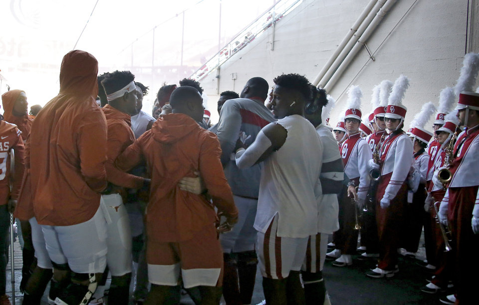 Photo - Oklahoma and Texas players shove each other in the tunnel before the Red River Showdown college football game between the University of Oklahoma Sooners (OU) and the Texas Longhorns (UT) at Cotton Bowl Stadium in Dallas, Saturday, Oct. 12, 2019. [Sarah Phipps/The Oklahoman]
