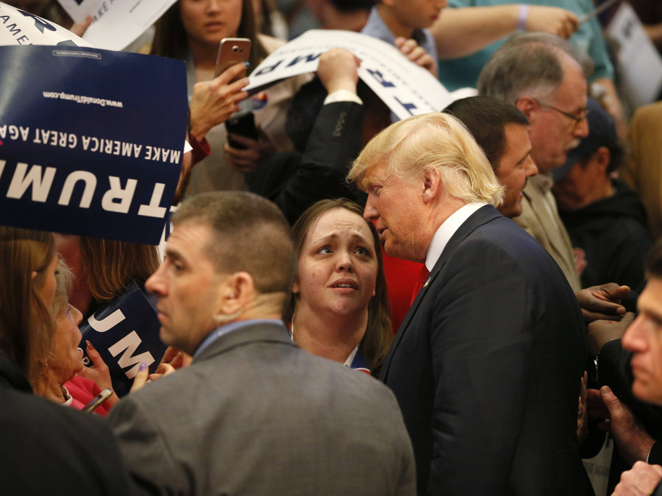 Photo - Republican presidential candidate Donald Trump takes photos with supporters after a rally at the Cox Convention Center in Oklahoma City, Friday, Feb. 26, 2016. Photo by Bryan Terry, The Oklahoman