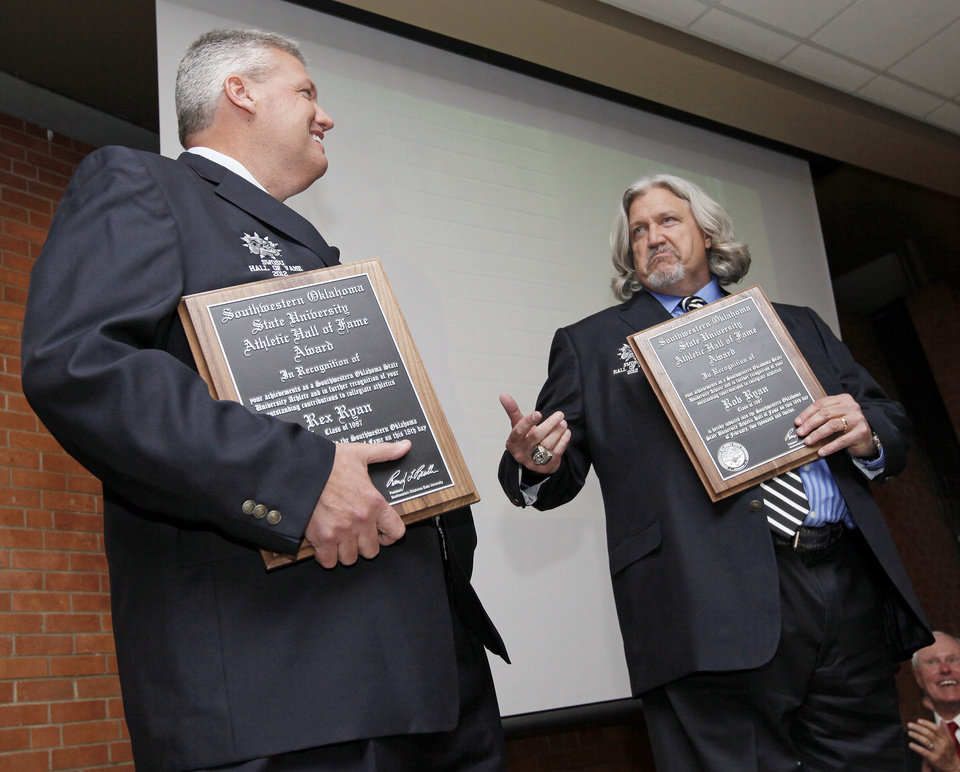 Photo - Rex Ryan, left, and Rob Ryan tell stories about their time at SWOSU during the banquet to induct the Ryan brothers into the SWOSU Athletics Hall of Fame at Southwestern Oklahoma State University in Weatherford, Okla., Saturday, Feb. 18, 2012. Photo by Nate Billings, The Oklahoman