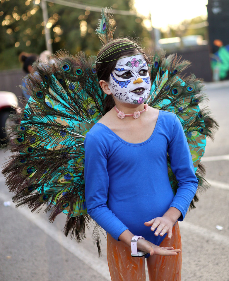 Photo - THE OK Magazine. Eleanor Ariyeh, 9, during the Day of the Dead festival in the Plaza District Sunday, November 3, 2019. Photo by Doug Hoke