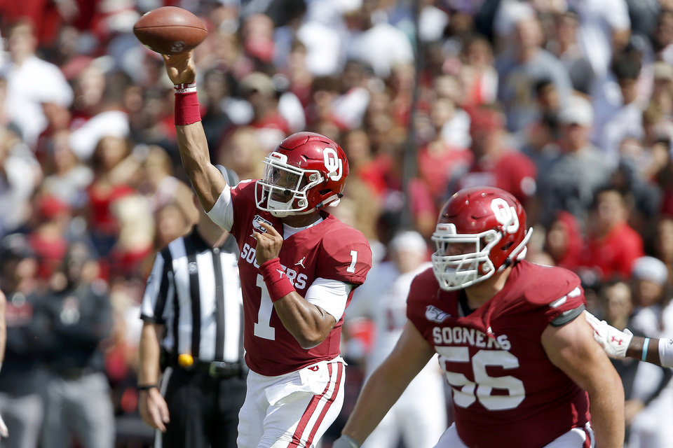 Photo - Oklahoma's Jalen Hurts (1) throws a pass during a college football game between the University of Oklahoma Sooners (OU) and Texas Tech University at Gaylord Family-Oklahoma Memorial Stadium in Norman, Okla., Saturday, Sept. 28, 2019. Oklahoma won 55-16. [Bryan Terry/The Oklahoman]
