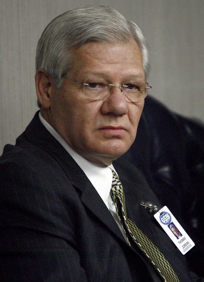 Photo - Tom Jordan listens to a special board meeting the Board of Medicolegal Investigations at the OSBI headquarters, Friday, Jan. 5, 2010, in Oklahoma City. Photo by Sarah Phipps, The Oklahoman.  ORG XMIT: KOD