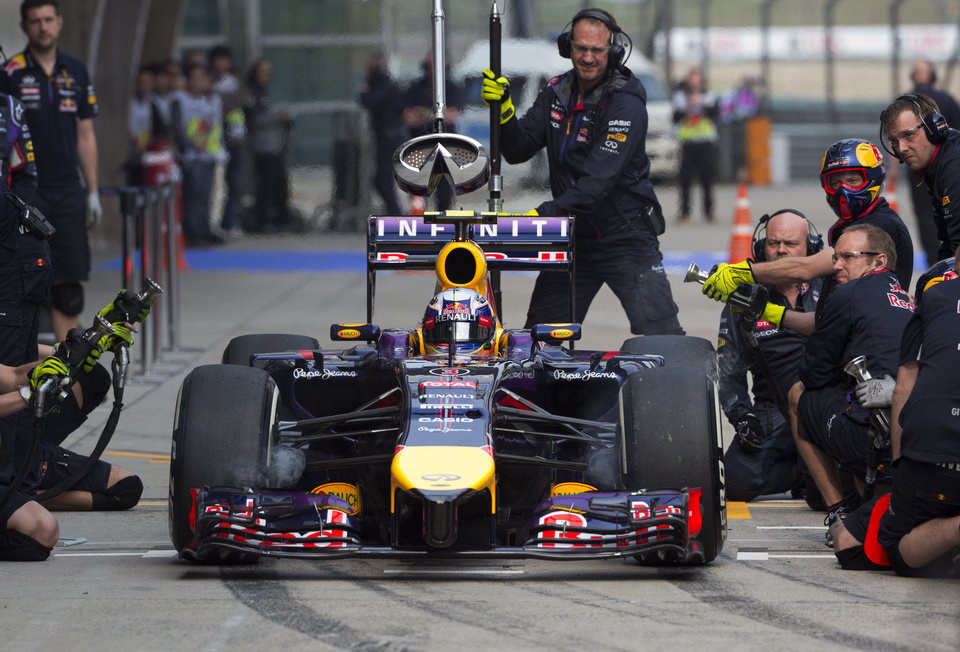 Photo - Red Bull driver Daniel Ricciardo of Australia drives out from the pit-lane during the practice session ahead of Sunday's Chinese Formula One Grand Prix at Shanghai International Circuit in Shanghai, China Friday, April 18, 2014. (AP Photo/Andy Wong)