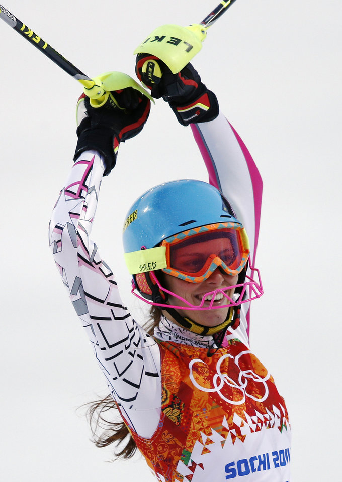 Photo - Lebanon's Jacky Chamoun smiles after completing the first run of the women's slalom at the Sochi 2014 Winter Olympics, Friday, Feb. 21, 2014, in Krasnaya Polyana, Russia. (AP Photo/Christophe Ena)