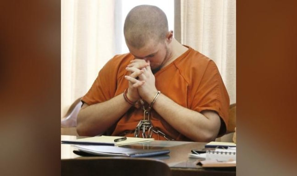 Photo -  Joshua Bryant sits with his head down during a court hearing Oct. 18, 2017, at the Oklahoma County Courthouse. He pleaded guilty Wednesday morning to the murder of his stepmother, Katherine Deena Bryant. [Nate Billings/The Oklahoman Archives]