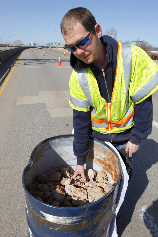 Ronnie Anderson, ODOT maintenance worker, with a barrel of concrete chunks of the highway being given away on the old I-40 Crosstown in Oklahoma City Wednesday, Feb. 29, 2012. The Oklahoma Department of Transportation let folks park and walk a section of the old highway in downtown Oklahoma City. Photo by Paul B. Southerland, The Oklahoman