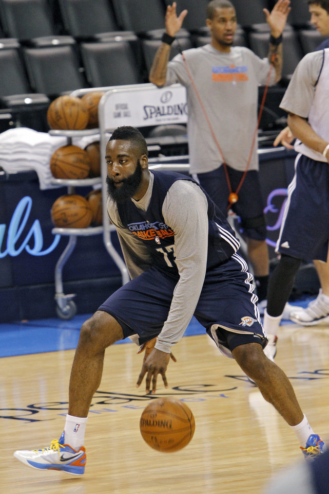 Photo - Oklahoma City's James Harden goes through drills during the NBA Finals practice day at the Chesapeake Energy Arena on Monday, June 11, 2012, in Oklahoma City, Okla. Photo by Chris Landsberger, The Oklahoman