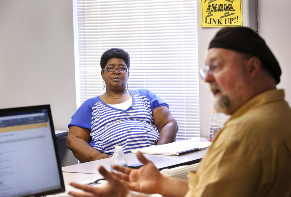Photo - Craig Dawkins teaches a personal finance class at Rose State College in Midwest City  that includes a few adult college students. Veda Lewis sits in a front row seat, listening to Dawkins lecture on Thursday. Photo  by Jim Beckel, The Oklahoman.  Jim Beckel - THE OKLAHOMAN