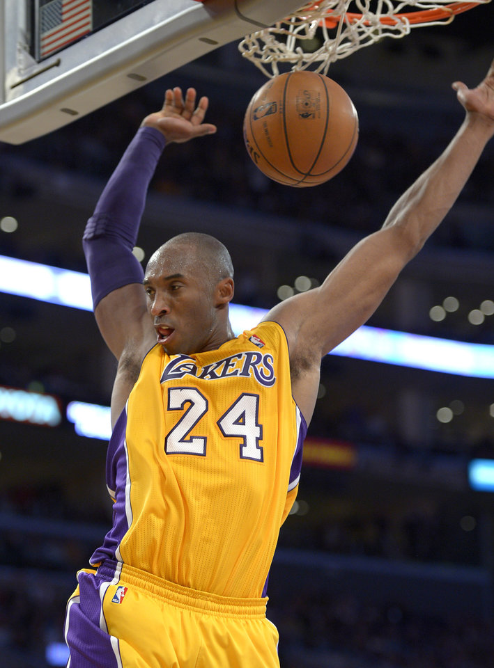 Photo -   Los Angeles Lakers guard Kobe Bryant dunks during the second half of their NBA basketball game against the Golden State Warriors, Friday, Nov. 9, 2012, in Los Angeles. The Lakers won 101-77. (AP Photo/Mark J. Terrill)