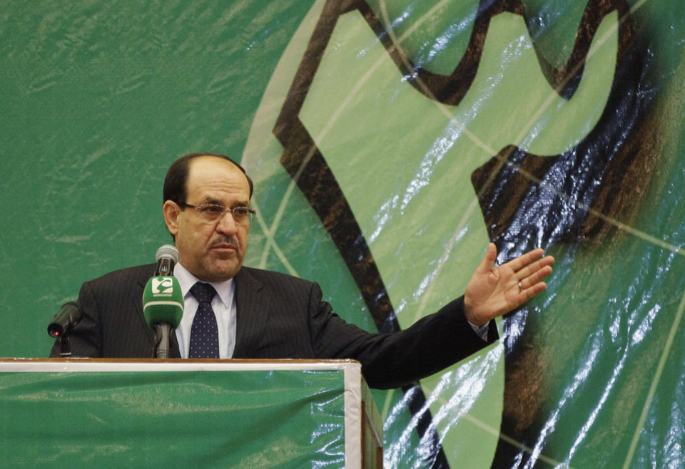 Photo - FILE - In this file photo taken Saturday, July 27, 2013, Iraqi Prime Minister Nouri al-Maliki speaks during the 32nd anniversary of the foundation of the Badr Organization in Baghdad, Iraq. The disastrous loss of a large swath of the north and two cities to Islamic militants is threatening to cost Iraq's prime minister, Nouri al-Maliki, a third term in office as his longtime Shiite backers turn against him and seek an alternative. (AP Photo/Karim Kadim, File)