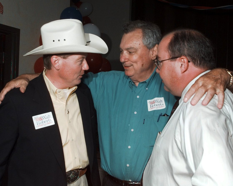 Photo - MCALESTER: Walt Roberts gets encouragement from Gene Stipe and Ben Odom at a watch party in McAlester.