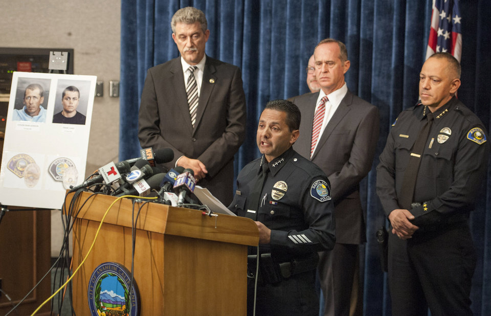 Photo - Santa Ana Police Chief Carlos Rojas speaks at a news conference, Monday, April 14, 2014, in Anaheim, Calif., to publicly discuss the deaths of four women allegedly raped and killed by two parolees wearing GPS trackers. (AP Photo/The Orange County Register, Leonard Ortiz)