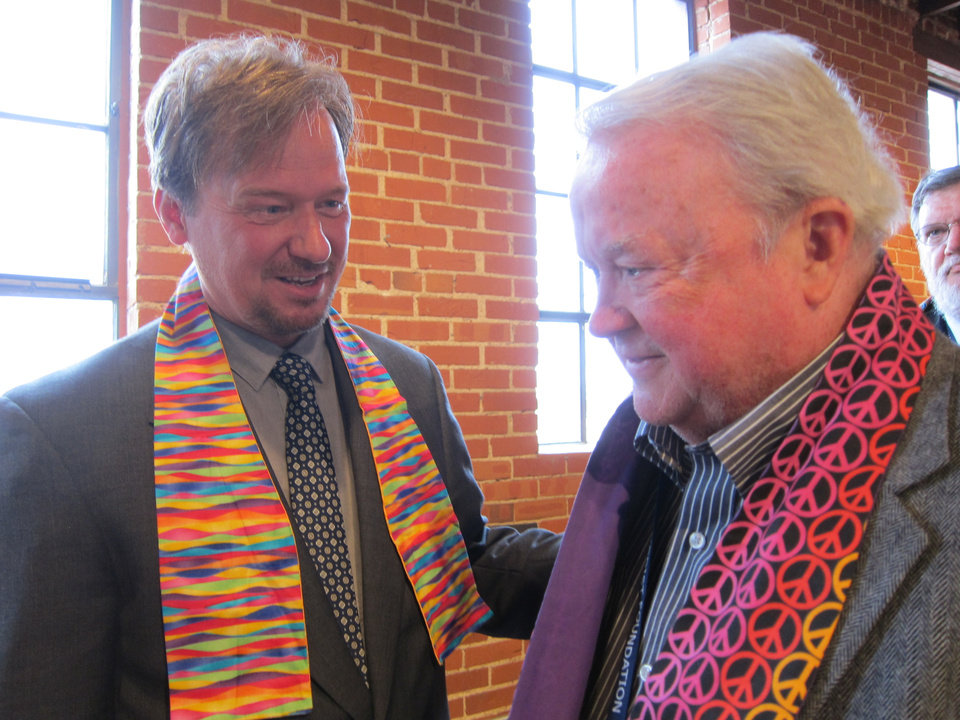 Photo - The Rev. Frank Schaefer, left, talks with the Rev. Jim Wheeler, a retired United Methodist minister from Oklahoma City, after Schaefer's presentation to a group of United Methodists on Tuesday in Oklahoma City.  Photo by Carla Hinton, The Oklahoman