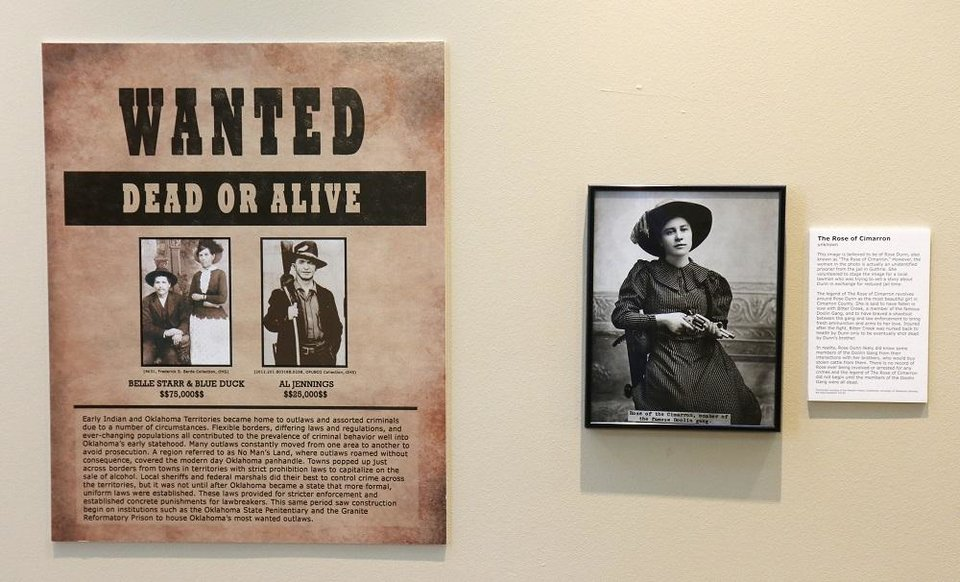 Photo - Wanted posters featuring Belle Star and Blue Duck and Al Jennings are displayed next to The Rose of Cimarron in the Oklahoma History Center's exhibit,