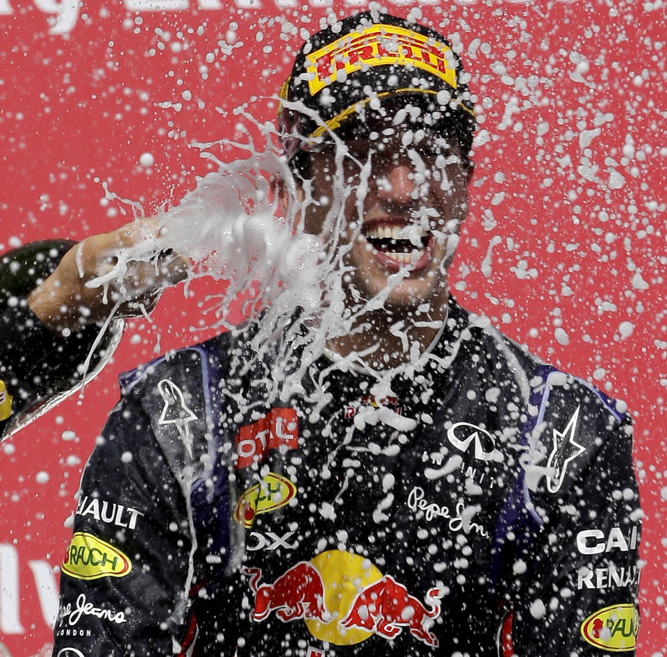 Photo - Red Bull driver Daniel Ricciardo, from Australia, celebrates as he is sprayed with champaign after winning the Canadian Grand Prix Sunday, June 8, 2014, in Montreal. (AP Photo/David J. Phillip)