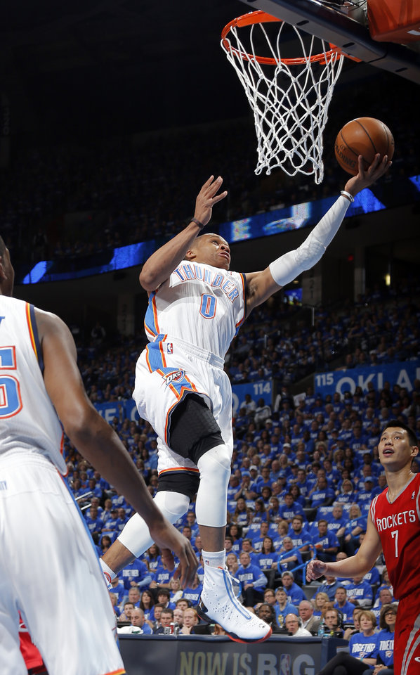 Oklahoma City\'s Russell Westbrook (0) shoots a lay up during Game 1 in the first round of the NBA playoffs between the Oklahoma City Thunder and the Houston Rockets at Chesapeake Energy Arena in Oklahoma City, Sunday, April 21, 2013. Photo by Sarah Phipps, The Oklahoman