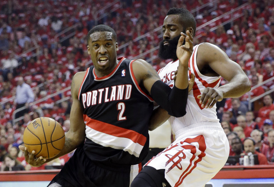 Photo - Portland Trail Blazers' Wesley Matthews (2) tries to drive past Houston Rockets' James Harden during the first half in Game 1 of an opening-round NBA basketball playoff series, Sunday, April 20, 2014, in Houston. (AP Photo/David J. Phillip)
