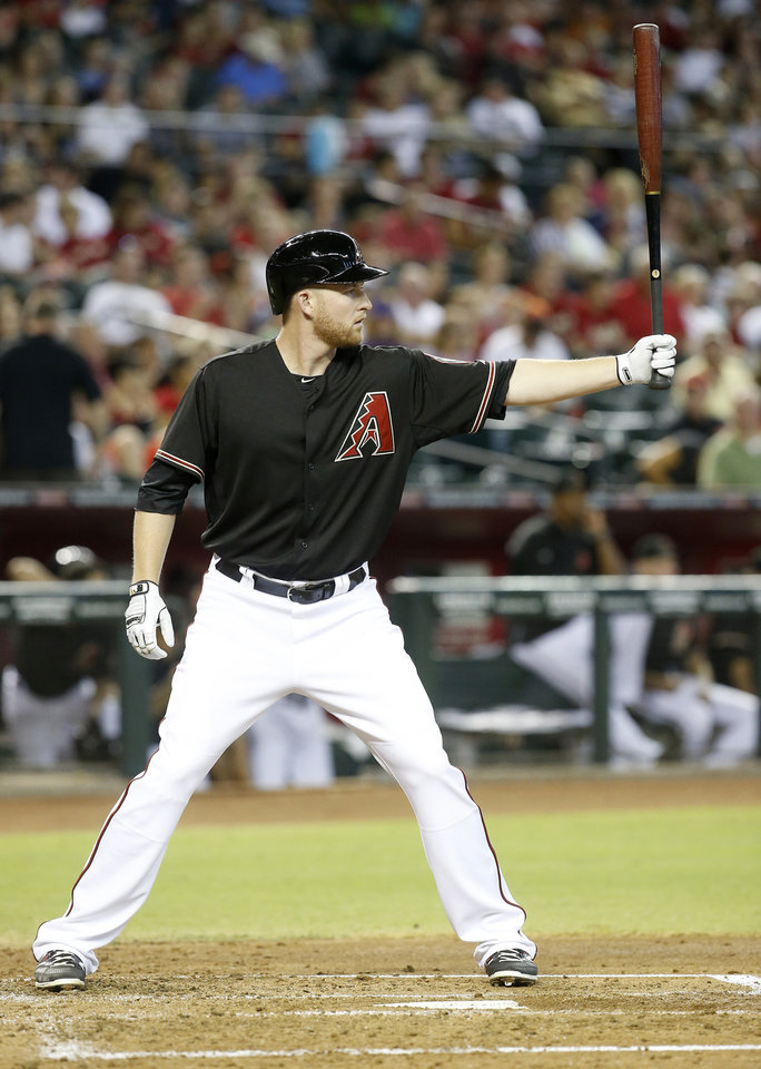 Photo - Arizona Diamondbacks' Mark Trumbo waits for a pitch in the first inning against the Colorado Rockies during a baseball game, Saturday, Aug. 9, 2014, in Phoenix. (AP Photo/Darryl Webb)