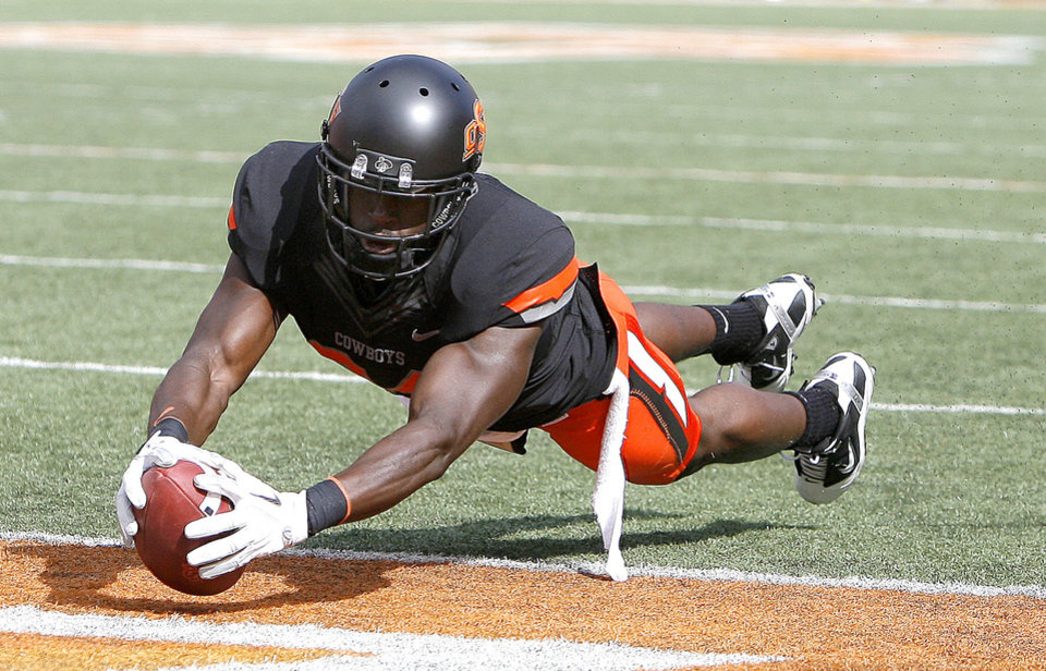 Oklahoma State\'s Hubert Anyiam (84) dives in for a touchdown during the first half of the college football game between the Oklahoma State University Cowboys (OSU) and the University of Kansas Jayhawks (KU) at Boone Pickens Stadium in Stillwater, Okla., Saturday, Oct. 8, 2011. Photo by Sarah Phipps, The Oklahoman ORG XMIT: KOD