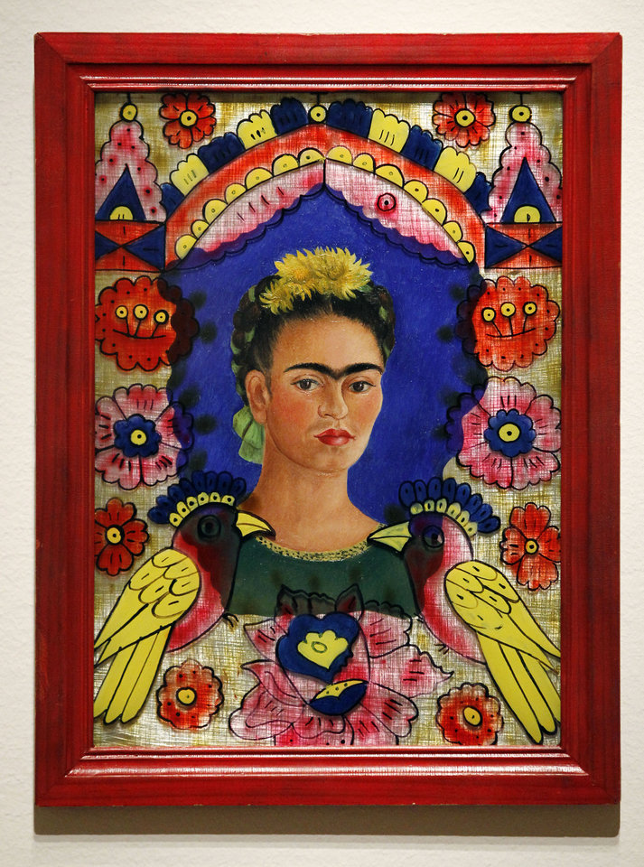 In this photo taken Tuesday, Oct. 9, 2012, a painting by Frida Kahlo (The Frame, 1938) is seen as part of one of two new exhibits featuring art exclusively by women at the Seattle Art Museum, in Seattle. Included in the exhibition is the only U.S. stop for an exhibit from the Pompidou Center in Paris, home of the modern art museum there, of painting, sculpture, drawing, photography and video. The exhibit runs through Jan. 13, 2013. (AP Photo/Elaine Thompson)