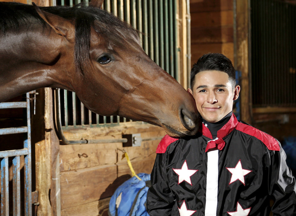 Photo -  Remington Park jockey David Cabrera poses for a photo with Tone Broke, the horse he will be riding Sunday night in the Springboard Mile. [PHOTO BY JIM BECKEL, THE OKLAHOMAN]