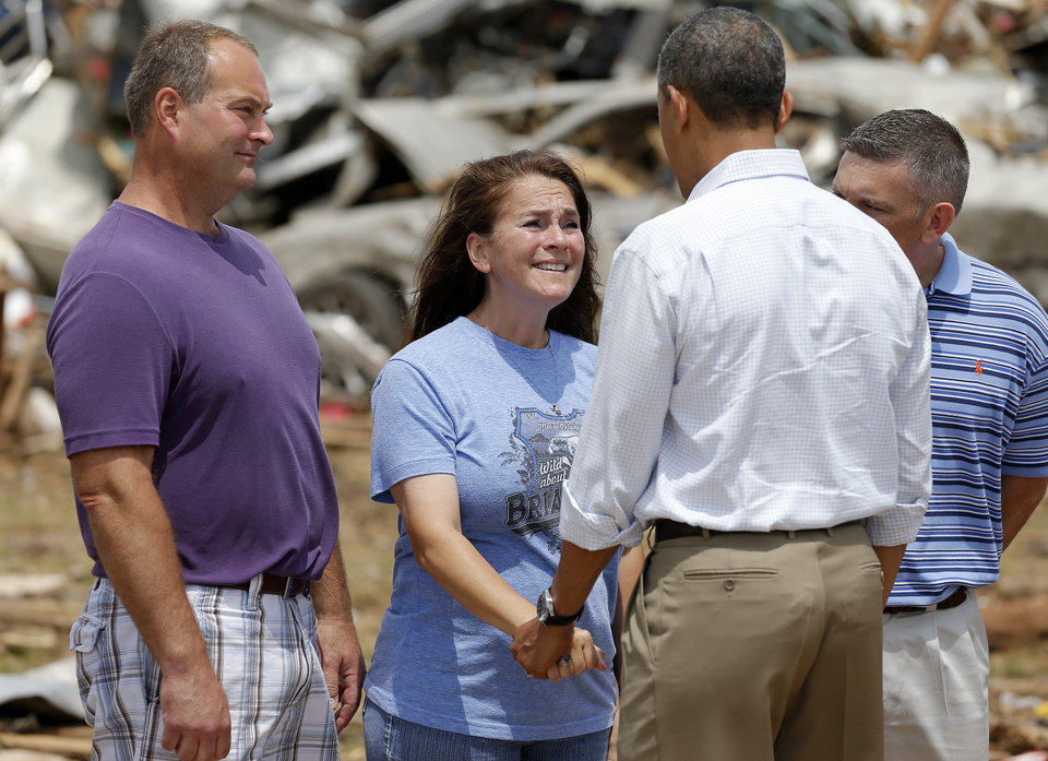Photo - President Barack Obama talks with Briarwood Elementary Principal Shelley McMillin outside Plaza Towers Elementary in Moore, Okla., Sunday, May 26, 2013. President Obama toured the area in Moore that was hit by a tornado on May, 20, 2013. Photo by Bryan Terry, The Oklahoman ORG XMIT: OKC1305261411038212