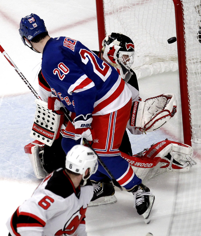 Photo -   New York Rangers' Chris Kreider (20) scores on New Jersey Devils goalie Martin Brodeur, rear, during the second period of Game 2 of an NHL hockey Stanley Cup Eastern Conference final playoff series, Wednesday, May 16, 2012, at New York's Madison Square Garden. (AP Photo/Julio Cortez)