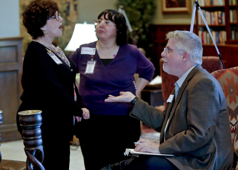 Author B. Kent Anderson speaks with Anne Masters, left, executive director of the Pioneer Library System, and Rosa Cantu at the Big Read kickoff event.