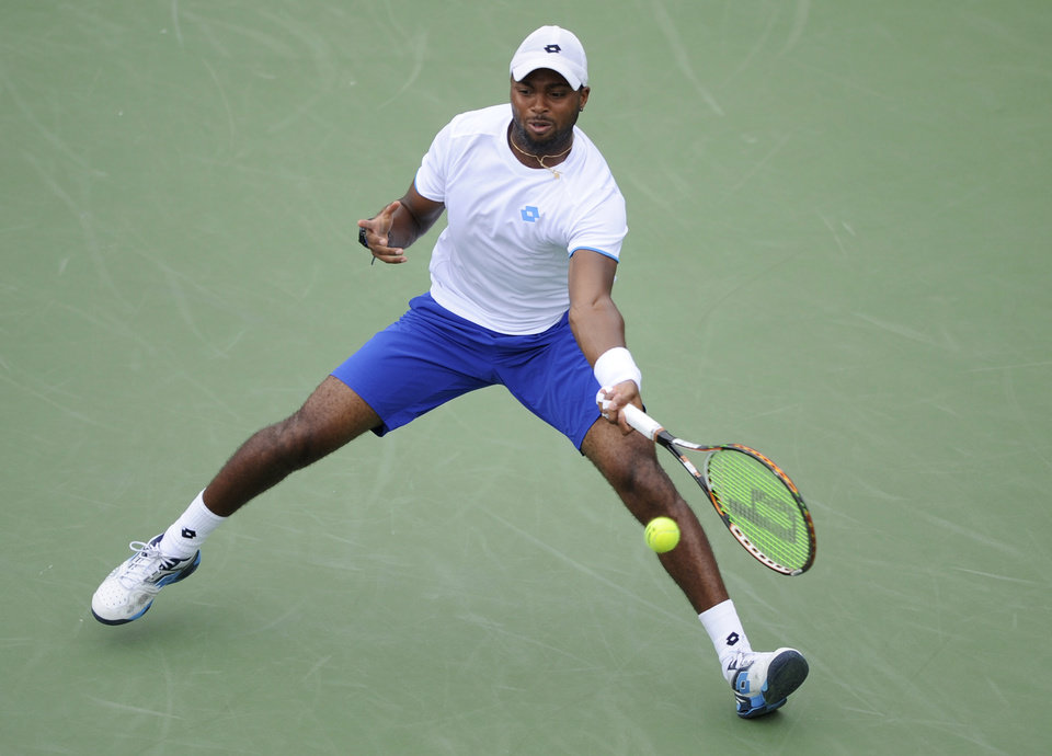 Photo - Donald Young reaches for the ball against Kevin Anderson, of South Africa, during a match at the Citi Open tennis tournament, Friday, Aug. 1, 2014, in Washington. (AP Photo/Nick Wass)