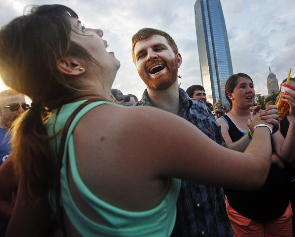 Photo - Cayla Lewis and Michael Hendrick of Oklahoma City dance as the Josh Abbott Band performs at OKC Fest in downtown Oklahoma City on Friday, June 27, 2014. OKC Fest is a new two day country music festival with multiple stages downtown. Photos by KT King/The Oklahoman