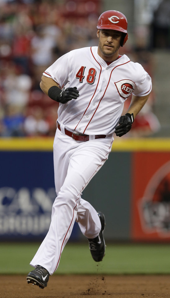 Photo - Cincinnati Reds' Ryan Ludwick rounds the bases after hitting a solo home run off Los Angeles Dodgers starting pitcher Dan Haren in the fourth inning of a baseball game, Monday, June 9, 2014, in Cincinnati. (AP Photo/Al Behrman)