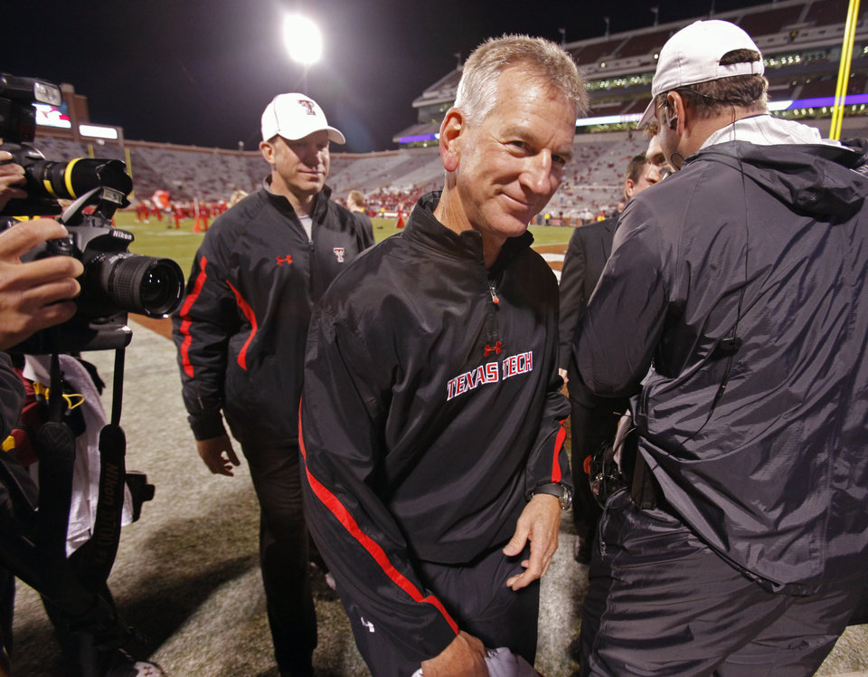 Photo - Texas Tech head coach Tommy Tuberville is all smiles as he leaves the field after the college football game between the University of Oklahoma Sooners (OU) and Texas Tech University Red Raiders (TTU) at the Gaylord Family-Memorial Stadium on Sunday, Oct. 23, 2011. in Norman, Okla.  Tech won 41-38.  Photo by Steve Sisney, The Oklahoman