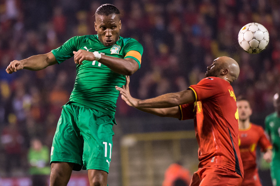 Photo - Belgium's Anthony Vanden Borre, right, challenges Ivory Coast's Didier Drogba during a friendly soccer match at the King Baudouin stadium in Brussels on Wednesday March 5, 2014. (AP Photo/Geert Vanden Wijngaert)